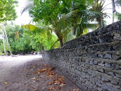 A coral wall delineates one neighbor's plot of land from another; Dhigurah Island