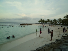 Locals enjoying themselves at the Artificial Beach at dusk; Male