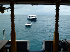 Our small motorboat and dhoni (dive boat) trail behind the MV Stingray