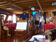 Deko giving us our dive brief as Alex, Gil and Roy look on; MV Stingray
