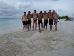"Shai, Roy, Amir, Gil, Andi, Robby and Matt pose behind Ido, the ""merman""; Raidhiga Island"