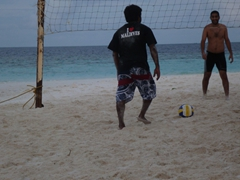 "Deko, our dive guide, wearing a ""I heart Maldives"" t-shirt while playing volleyball; Raidhiga Island"