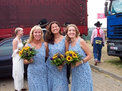 Gabi, Becky and Maria strike a bridesmaid pose at Barb & Steve's Stuttgart Rodeo Wedding