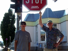 "Luke and Bob stand under a ""STOP EATING ANIMALS"" sign in Feuerbach"