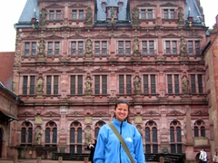 Becky stands in front of a remarkably well preserved section of the ruined Heidelberg Castle