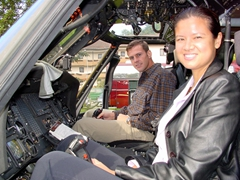 Becky and Robby get behind the cockpit of a helicopter at the 2003 Land Combat Exposition at Patrick Henry Village; Heidelberg