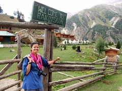 Becky at the entrance gate of Raikot Sarai Cabins, Fairy Meadows