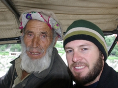 A blue eyed hitchhiker strikes a pose with Robby on our jeep ride back down to Raikot Bridge