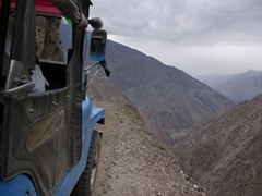 Robby leans out of the jeep and snaps a photo of our jeep ride back down to Raikot Bridge