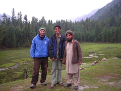 The guys strike an early morning pose in the front yard of Fairy Meadows Cottages