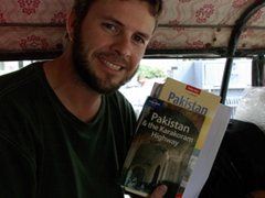 Robby poses with our Lonely Planet guidebook and Nelles Pakistan map