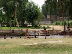 Lots of villagers gathered down by the river to jump in and cool off from the summer time heat