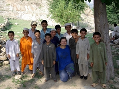 Its a smiling contest! Becky poses with the boys of Chakdarra