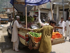 Fresh vegetables catch our eye as they are sold off the back of this truck; Dir Bazaar