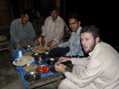 Hamid, our Kalash host, Saeed and Robby enjoy a simple (and tasty) dinner; Birir Valley Kalash Guest House