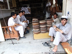 Robby contemplated buying a pakol (a round shaped cap made out of a coarse woolen cloth) to match his shalwar kameez