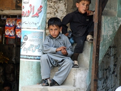 Two boys give us a curious stare down as we wander the Dir bazaar