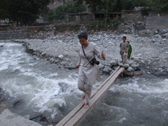 Becky has to cross the river to get to our homestay at the Kalash Guest House