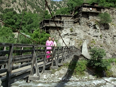 Posing on a wooden bridge leading to the Kalash Guest House, our homestay lodgings in Birir Valley