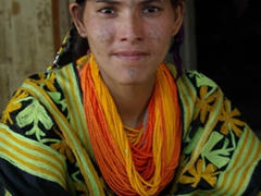 This beautiful Kalasha woman had clusters of dots tattooed on her forehead, cheeks and chin