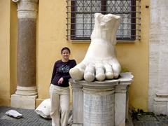 Becky strikes a pose next to a marble foot of the Colossus of Constantine, a giant statue of Constantine (famous for being the first emperor to convert to Christianity); courtyard of Palazzo dei Conservatori, Capitoline Museum