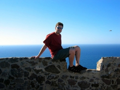 Robby perched on ledge of castello, Castelsardo