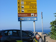 Street sign showcasing Castelsardo's highlights: the Castello, the Cattedrale, or the Belvedere