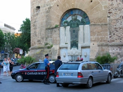 Police in front of the fortified, medieval Castello (for which the city is named), dating back to 1100 A.D., Castelsardo