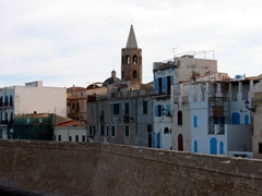 14th Century St Francis Church's pointed Aragonese tower dominates the lovely city of Alghero