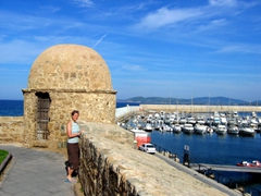 Becky stands near the harbor at the Port of Alghero, Sardinia