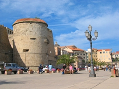 View of Alghero's thick fortress walls, as seen from the marina
