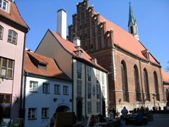 View of the Konventa Seta (Convent Court), which is a historic complex of 9 medieval buildings in the heart of Old Riga showcasing apartments for rent and small shops