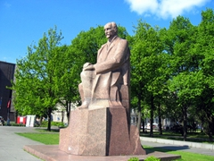 Granite statue in park next to Reval Hotel Latvija