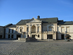 View of the 19th Century Klaipeda Theater (famous because Hitler spoke from the balcony). A sculpture of Ann from Tharau stands in a fountain in the middle of the square
