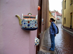 Becky checking out tea pots embedded in the wall; Vilnius
