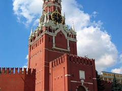 The famous Spasskaya tower with a portal through the eastern wall of the Kremlin overlooking the Red Square. In 1935, the two headed eagle atop the tower was removed, and replaced by a red star which remains till today
