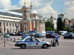 A Moscow policeman on duty (with his car parked nearby)