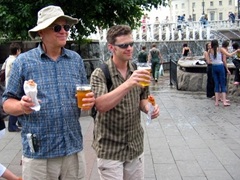 Bob and Robby successful in their quest for a hotdog and cold beer