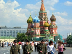 Russian soldiers walking across Red Square with Saint Basil's Cathedral in the background