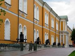 Guards pace around the Kremlin despite the rain