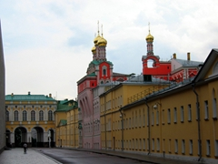 A brightly colored cathedral within the walls of the Kremlin stands out