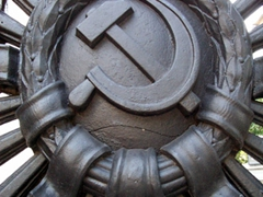 Hammer and Sickle communist symbol on a gate in Kiev