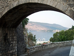 Waterfront view of the Bay of Kotor from an old stone bridge
