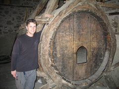 Robby poses next to a large wine barrel at Varlaam Monastery