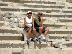 "Ann and Bob sitting on the emperor's throne at the Theatre of Dionysos (Bob is striking the ""thinkers"" pose)"