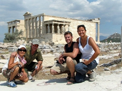 Group photo at the acropolis with the sacred site of Erechtheion in the background