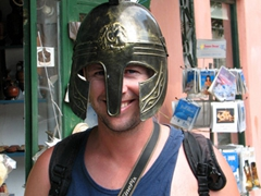 Robby dons a Greek helmet (it was surprisingly heavy!)