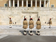 """The hourly changing of the guards is a very popular tourist attraction, and is performed by the elite light infantry and mountain units of the Greek Army, known as """"Evzones"""""""