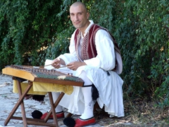 A musician performs in traditional Greek costume