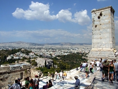 Throngs of tourists crowd at the Acropolis's Beule Gate and the Propylaea